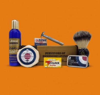 wet shaving kit orange background